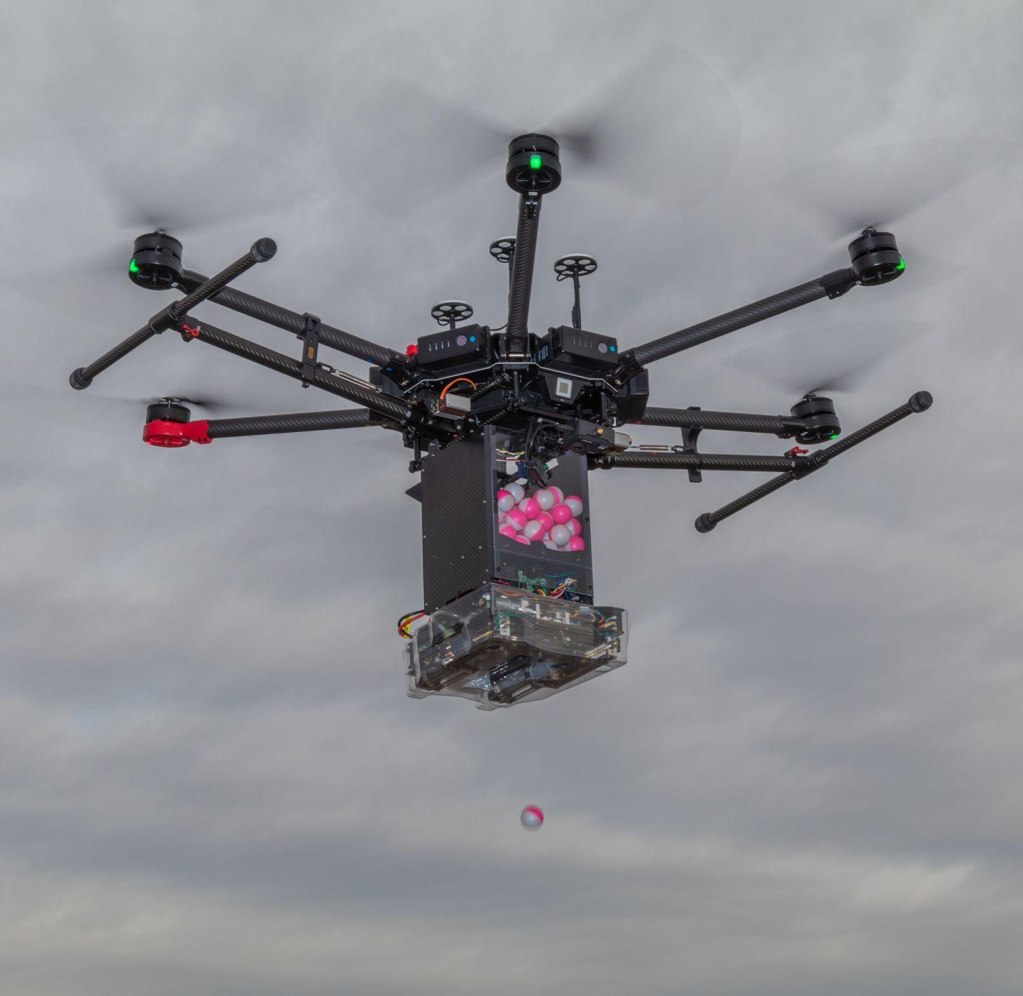 Drone Amplified's IGNIS system uses ping-pong-ball-sized chemical spheres to start prescribed burns or to fight wildfires.