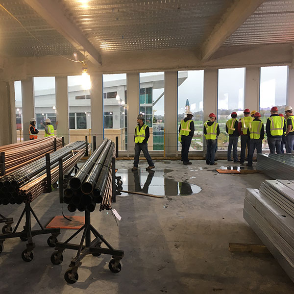 Durham School students, including AGC student members, tour the HDR headquarters under construction in Aksarben Village in Omaha.