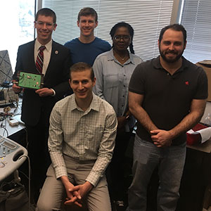 Dr. Peter Pellegrino (front), a cardiovascular researcher and medical resident at University of Nebraska Medical Center, is working with a team of electrical and computer engineering students -- (back from left) Patrick Davlin, Nick Masur, Mai Zakaria Ahmad Morgan and Michael Lehman -- on developing a non-invasive device that would allow for the study of the sympathetic nervous system.