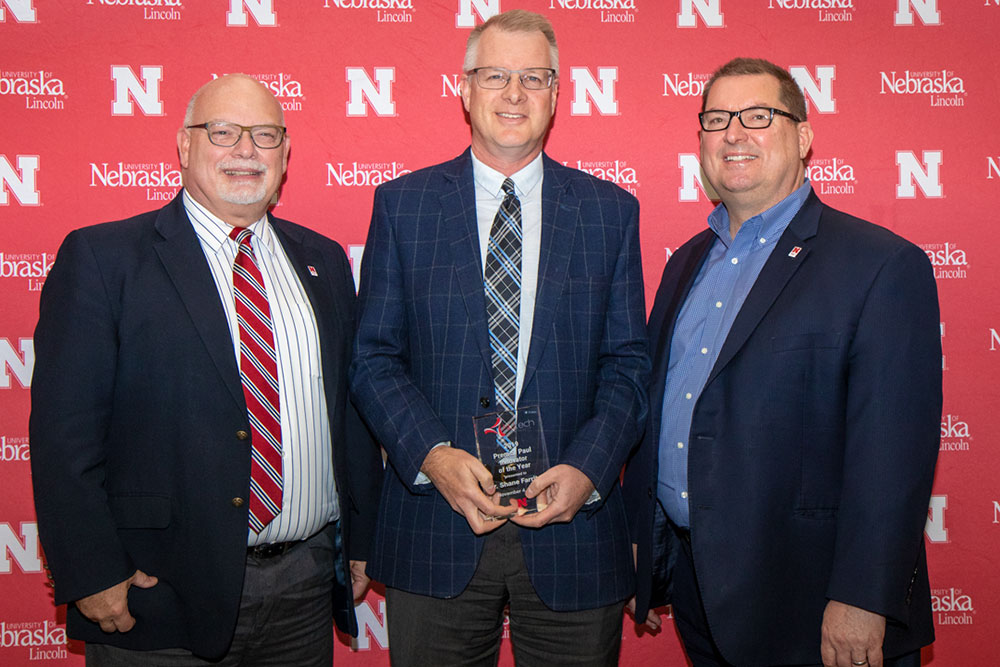 Shane Farritor (center), professor of mechanical and materials engineering and chief technical officer of Virtual Incision, receives the Prem S. Paul Innovator of the Year Award from Brad Roth (left), NUtech Ventures executive director, and Bob Wilhelm, University of Nebraska-Lincoln vice chancellor of research and economic development.