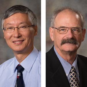 "A UNL engineering team that includes Tian Zhang (left), professor of civil engineering; and John Stansbury, associate professor and associate chair of civil engineering -- received the Rudolph Hering Medal for its paper, ""Contributions of Internal and External Fouling to Transmembrane Pressure in MBRs: Experiments and Modeling."""