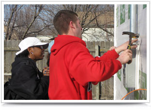 A UNL construction management student helps renovate facilities for neighbors in need.