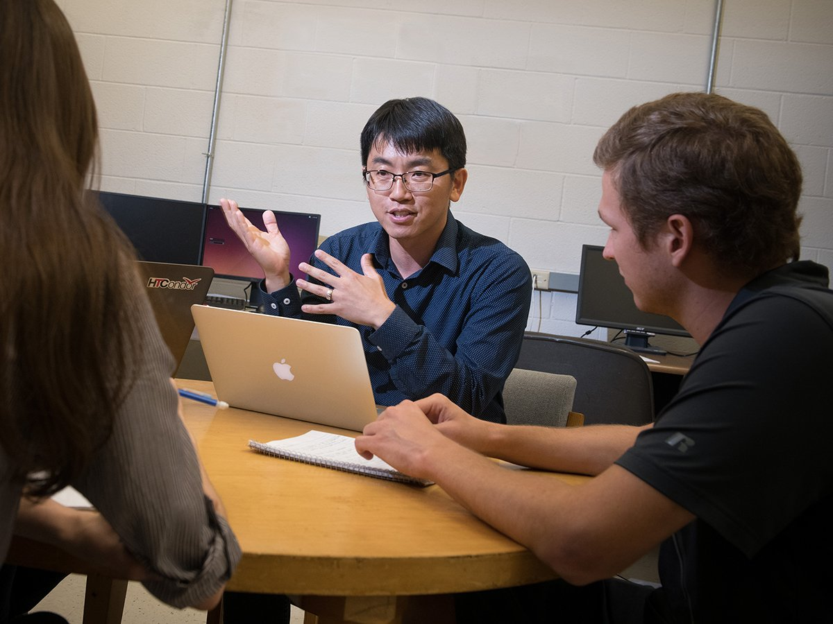 Jae Sung Park meets with students on his research team.