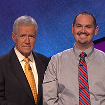 "Austin Yates (right), a civil engineering graduate, has his picture taken with ""Jeopardy!"" host Alex Trebek after Yates appeared on an episode that was recorded in late August."