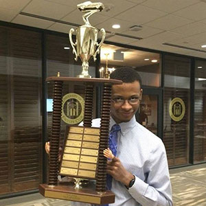 Julian Davis, a chemical and biomolecular engineering major, holds the first-place trophy after a team of Nebraska Engineering students won the Chem-E-Car competition at the AIChE Mid-America Student Regional Conference.