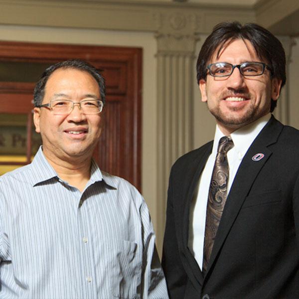 Junke Guo (left), associate professor of civil engineering, and Sher Jan Ahmadzai, director of the University of Nebraska-Omaha Center for Afghanistan Studies.