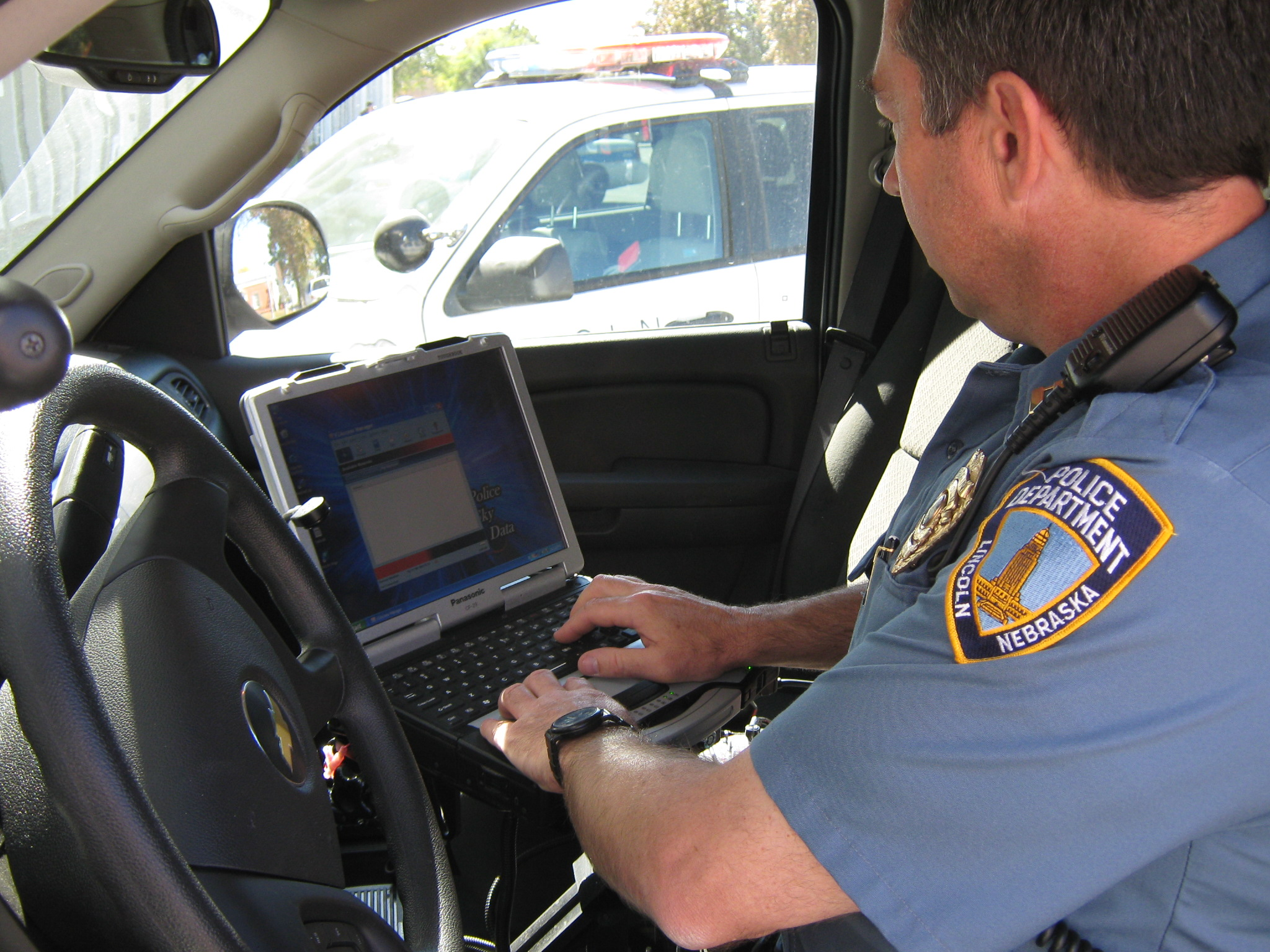Captain Jim Davidsaver of the Lincoln Police Department uses the mobile data computer in his cruiser. UNL researchers are working with LPD to test smart phones and GPS-enabled laptops to improve patrol duties.