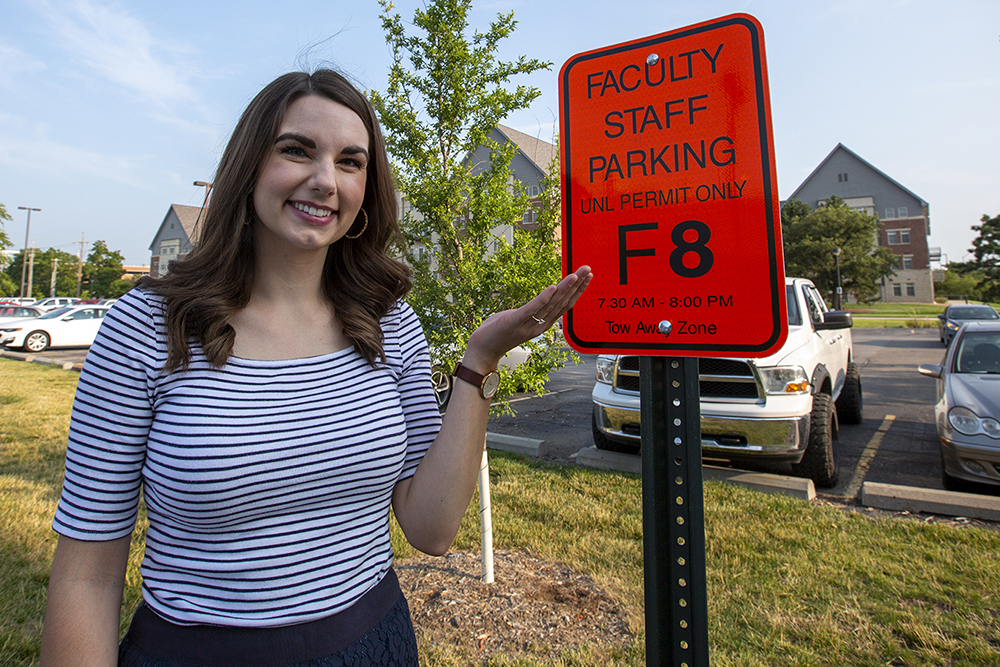 Bonnie Martin stands next to her reserved parking sign near Nebraska Hall. The university will continue giving prizes away to those who are fully vaccinated and complete the voluntary registry through Aug. 13. A grand-prize drawing is scheduled for after Aug. 15. (University Communication)