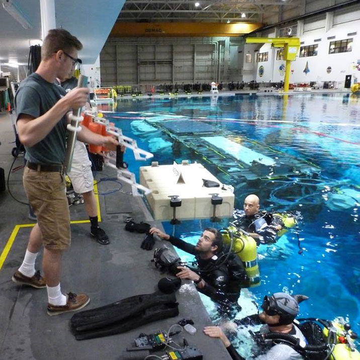 Student engineers from UNL's Air and Space Research (ASR) test a gap spanner in the Neutral Buoyancy Laboratory at the Johnson Space Center in Houston, Texas, in early June. The device was designed as part of the NASA Micro-g NExT Challenge.