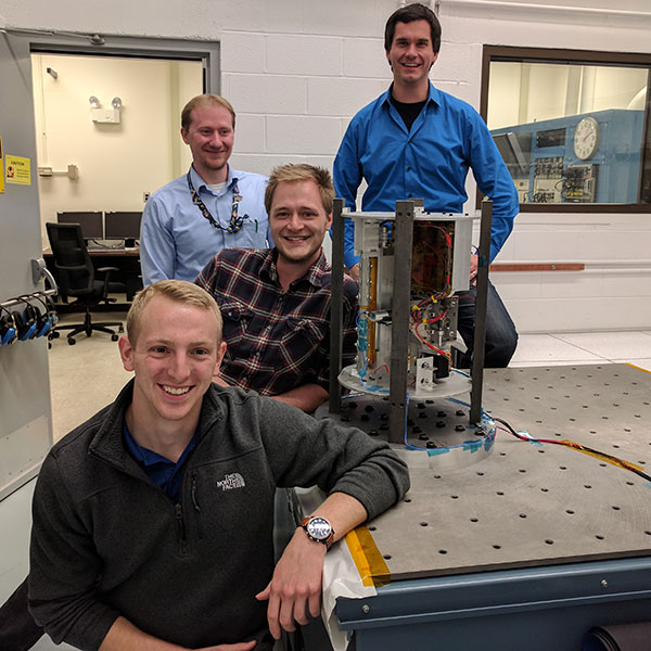 Nebraska Engineering student Ethan Krings and alumni Chris Volle, Matthew Mahlin and Justin Green were part of the team that developed a boom that would be used in space to support a flexible solar panel.