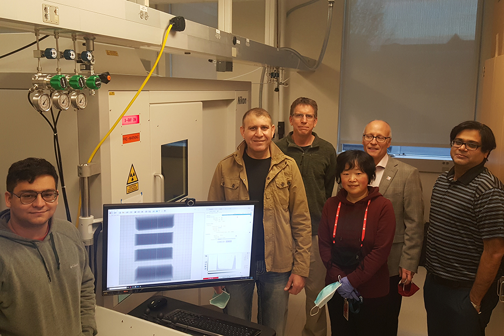 Researchers from the Nano-engineering Research Core Facility (NERCF) – (from left) Andrew Menendez, Ziyad Smoqi, Jeff Shield, Wen Qian, Joseph Turner, Prahalada Rao – stand with the new Nikon X-Ray Computed Tomography machine that can make high-powered, 3D scans of materials.