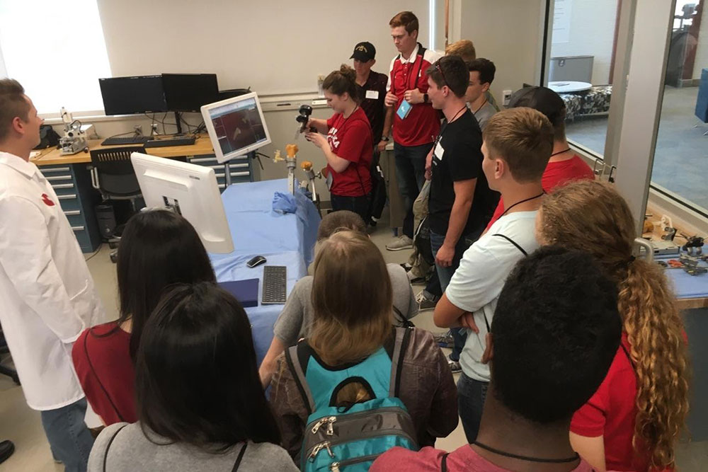 First-year engineering students get an up-close look at a surgical robotic device during a tour of the University of Nebraska Medical Center in Omaha during the 2017 NUBE Experience E-Day in Omaha.