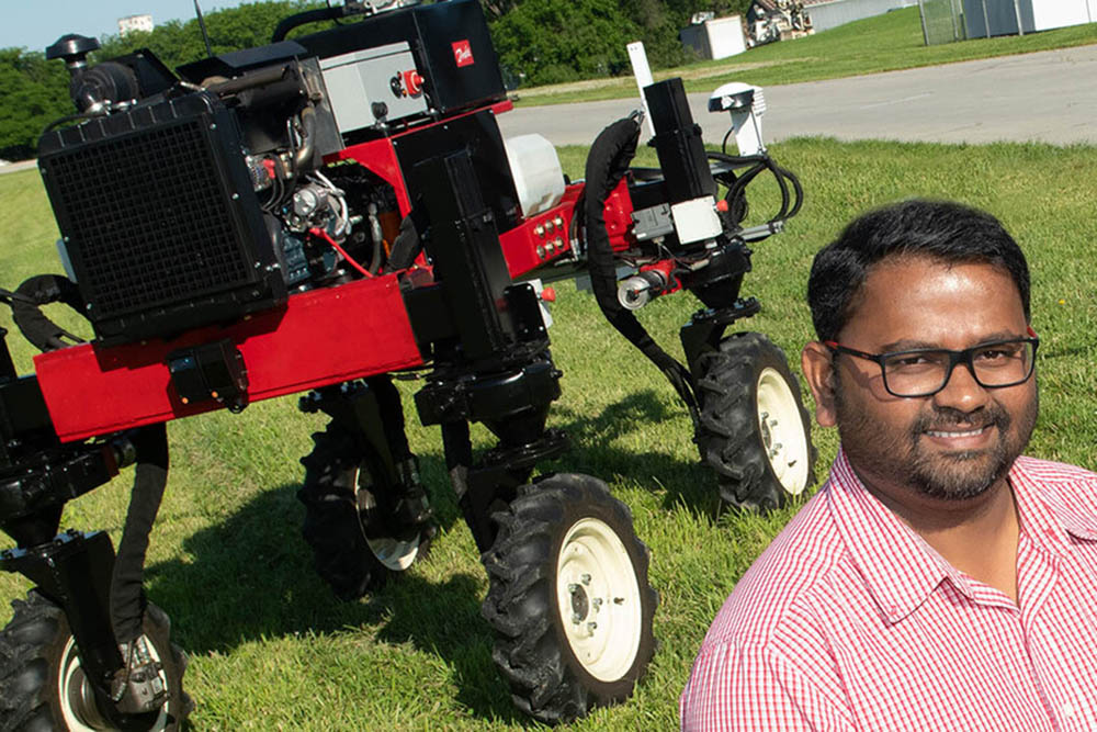 Santosh Pitla, associate professor of biological systems engineering at Nebraska, and his team are working on a new approach for refilling Unmanned Ground Vehicle seed tanks using aerial robots. (University Communication)