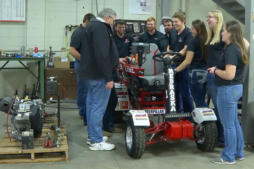 Roger Hoy, professor of biological systems engineering, and the Nebraska quarter-scale tractor team discuss plans for their 2020 tractor. (Farm Journal AgWeb)