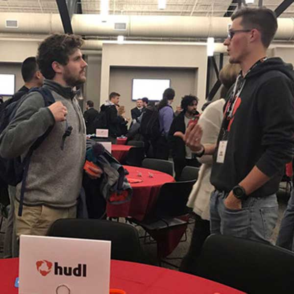 A Nebraska student talks with a Hudl representative during the Reverse Pitch event in January. The job exploration series continues through April.
