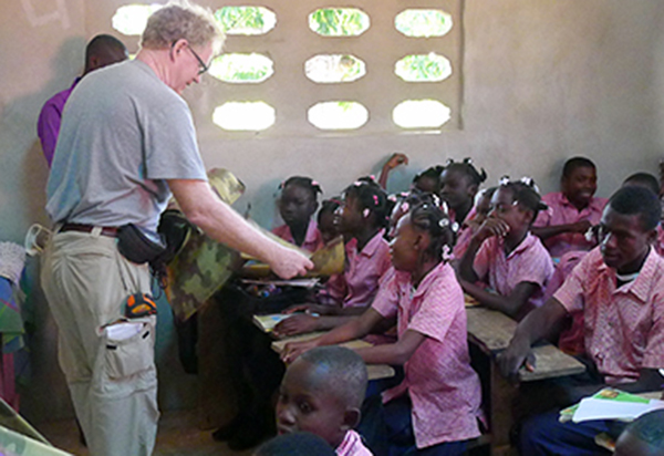 Durham professor James Goedert interacts with students in the new Flower of Hope School building.