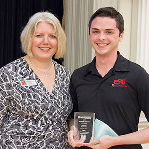 Danny Fell (right) accepted two awards at the UNL Student Involvement Student Impact Awards banquet on Thursday, April 6 at the Nebraska Union. Fell was honored as the Outstanding Student Organization Member for his work with Engineering Student Advisory Board (eSAB) and also accepted the award for Program of the Year, given to eSAB for E-Week.