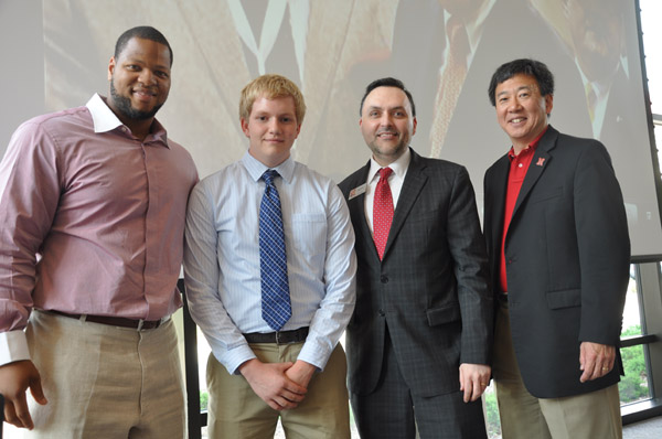 From left, Ndamukong Suh stands with Matthew Stier, first recipient of the scholarship Suh established with the UNL College of Engineering; with them are Eddy Rojas, director of UNL's Durham School of Architectural Engineering and Construction, and UNL College of Engineering Dean Tim Wei.