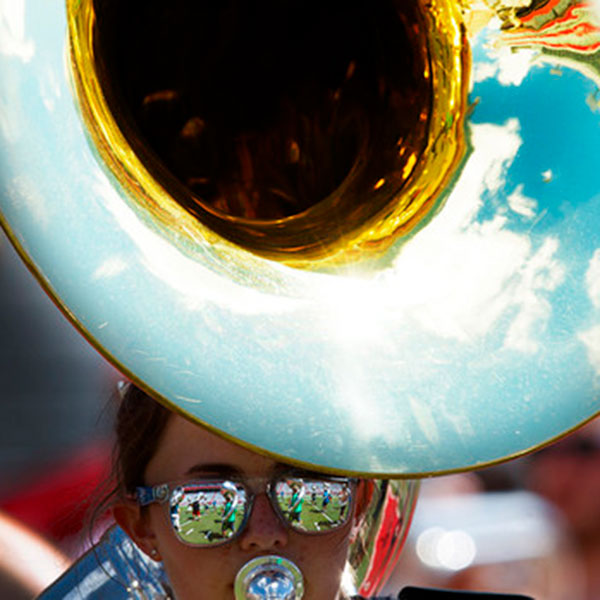 Kelsey Reeves, a sophomore in biological systems engineering, plays a sousaphone during Cornhusker Marching Band practice Aug. 16 in Memorial Stadium. Reeves is one of 36 College of Engineering students who are in the marching band this season. (Craig Chandler / University Communication)