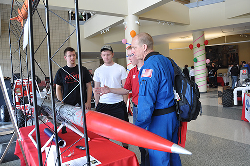 Members of the UNL Rocket Team meet with Nebraska-born NASA astronaut Clayton Anderson (in blue) during the 2013 Engineering Week Open House at Othmer Hall on April 12.