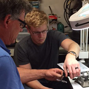 Derek Wallin (right), a senior mechanical and materials engineering major, works with Dr. Steven Barlow, professor of special education and communication disorders, on the design of a biomedical device for a capstone project. Wallin is the only mechanical engineer on the project being overseen by the Jeffrey S. Raikes School of Computer Science and Management.