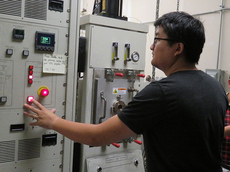 Xueliang Yan, postdoctoral researcher, operates a machine that allows high-temperature testing of materials that Bai Cui's team is developing for use in the next generation of nuclear reactors.