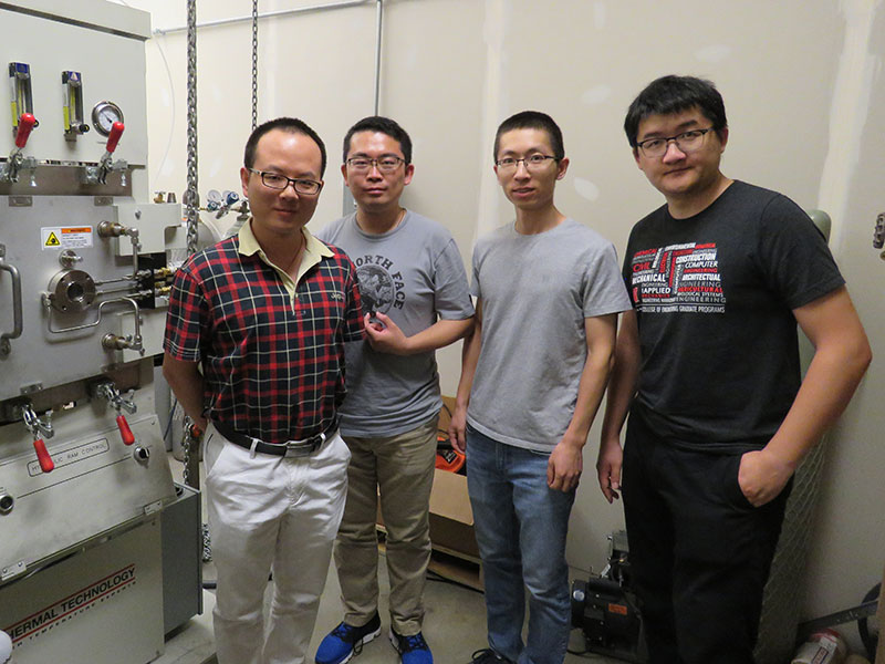 A team of Nebraska mechanical and materials engineers -- including (from left) assistant professor Bai Cui, Ph.D. students Fei Wang and Xiang Zhang and postdoctoral researcher Xueliang Yan -- is developing new materials to be used in the next generation of nuclear reactors.