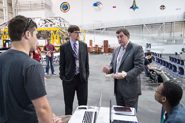 NASA engineers from Johnson Space Center in Houston, Texas, give feedback on the sample collection tool designed by the UNL Air and Space Research team.