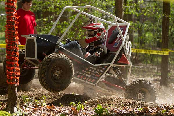 Driver Eric Rice tries to maneuver the Husker Racing Baja SAE team over a log obstacle during the endurance race at the Cookeville, Tennessee, event in April.