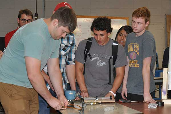 Team nine - which included Mary Hernandez, David Marshall, Jacob Meyer, Lukas Samuelson and Jared Thomsen -- prepares its entry in the Rapid Design Challenge.
