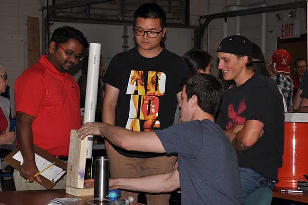 Rapid Design Challenge judge Santosh Pitla, assistant professor of biological systems engineering, discusses the deign of a device with the team of Zachary Duncan, Nicole Schwery, Dillon Soukup and Zhichen Wang.
