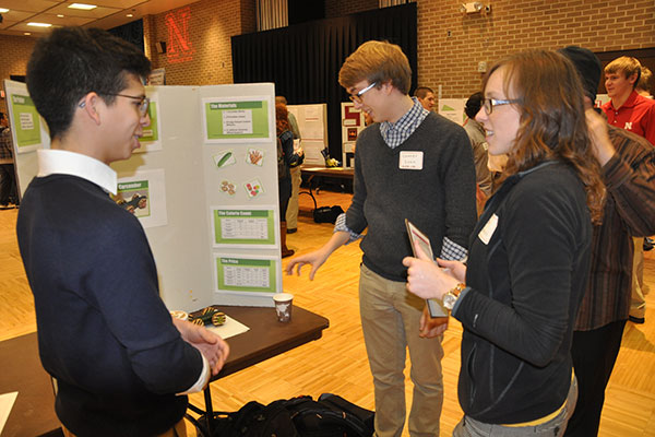 Judges interview students about their projects and evaluated their posters that detailed the process of constructing cars for the Incredible, Edible Vehicle Competition.