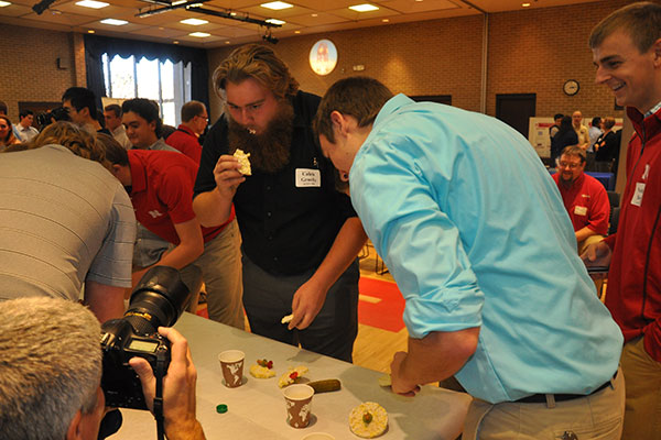 Caleb Gruefe and Jacob Kreiekemeier start eating rice cake wheels as teams devoured their cars at the end of the Incredible, Edible Vehicle competiton.