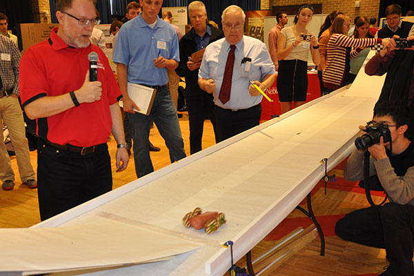 Mark Riley, department head of biological systems engineering, provides the play-by-play of the action during the Incredible, Edible Vehicle Competition.