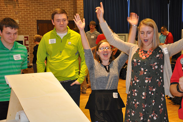 Team members (from left) Paul O'Dell, Gavin Taylor, Bethany Mahan and Jane Adams react as their car flies down the ramp.