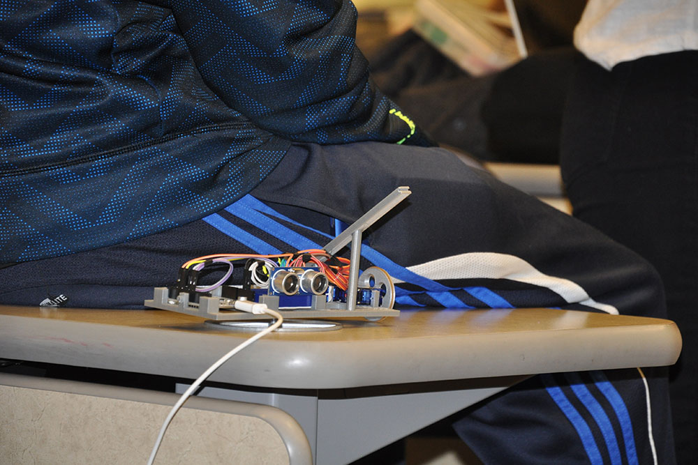 Devices like this one were created by students in ELEC 121 for the purpose of shooting a rubber band from inside a three-sided box.