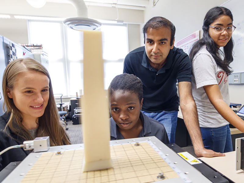 Christine Wittich and students test a rubber model on the shake table.