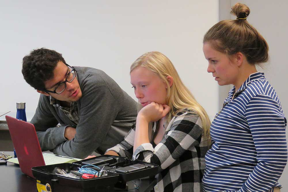 During a senior design capstone team meeting, biological systems engineering students (from left) Ravi Raghani, Emilie Johnson and Jordan Verplank discuss the redesign of a toy electric car that will enable mobility challenged toddlers to have more autonomy over their movements.