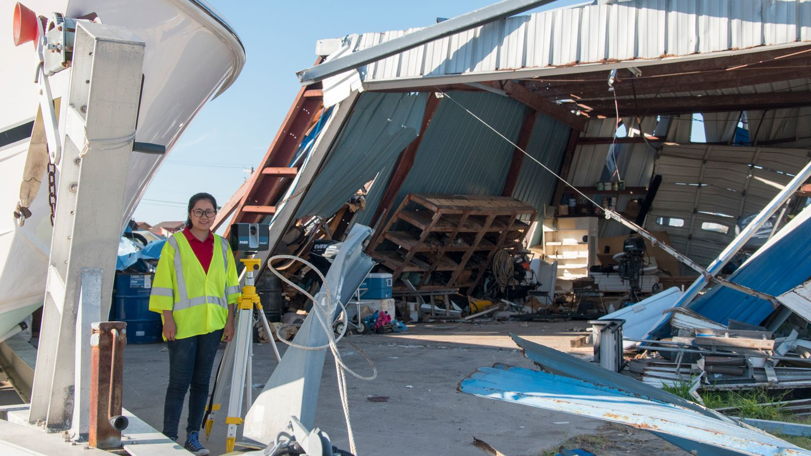 Yijun Liao collecting lidar measurements at a boat repair shop in Port Aransas, TX.