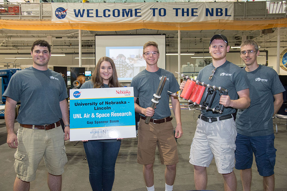 The UNL Air and Space Research team - (from left) Luke Monhollon, Claire Ashley, Nathan Borcyk, Brandon Jackson and Carl Nelson, professor of mechanical and materials engineering - designed a gap spanner boom for the NASA Micro-g NExT Challenge.