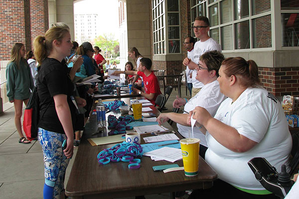 One of the 600 walkers who participated in the April 17 Out of the Darkness Campus Walk, registers at a table north of the Nebraska Union.