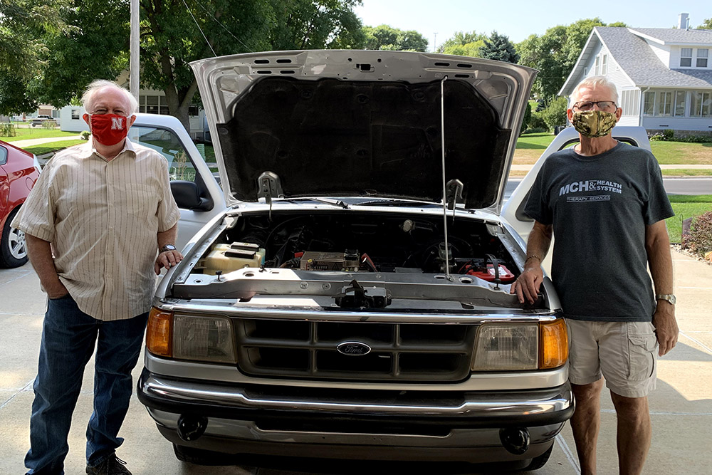 On behalf of the college, Jerry Hudgins (left), chair of electrical and computer engineering, accepted a donation from Paul Smith, who lives in Blair, Nebraska, of a pickup truck Smith converted from fossil-fuel engine to all-electrical systems.