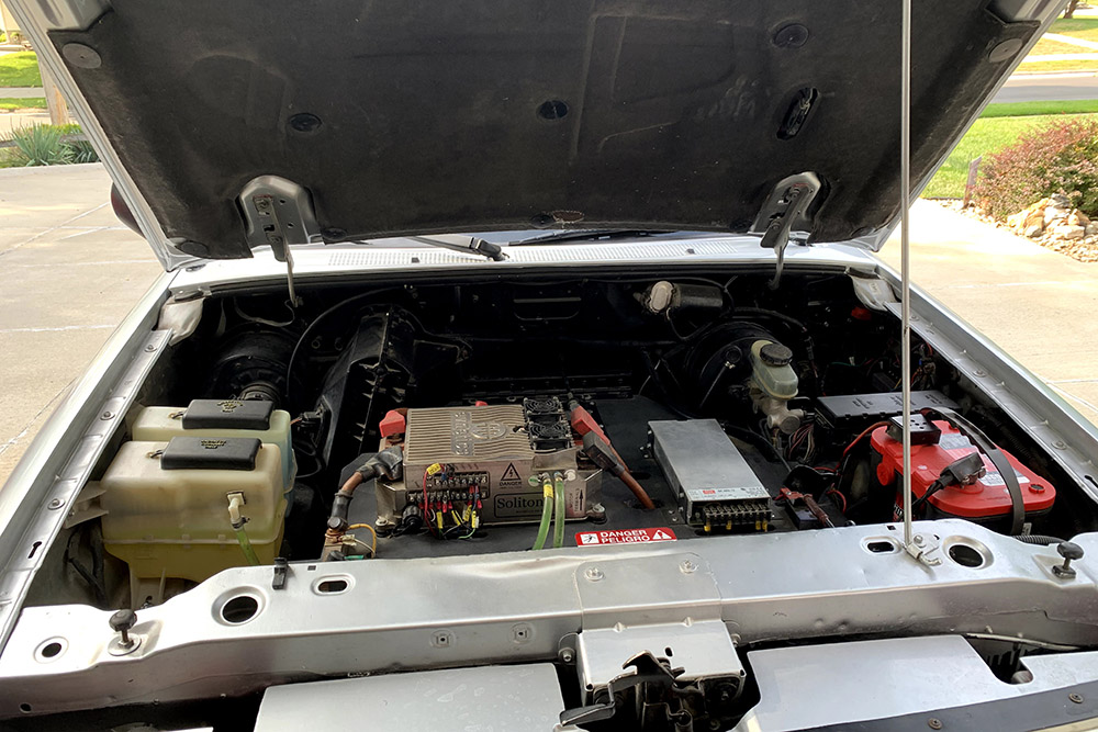Paul Smith installed control systems under the hood of a 1994 Ford Ranger pickup while converting it to all-electrical systems.