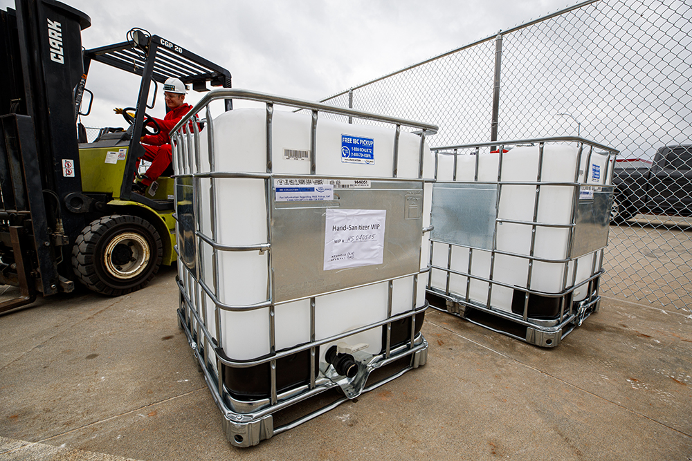 Russell Parde uses a forklift to move containers of chemicals being used to produce hand sanitizer. (Craig Chandler / University Communication)