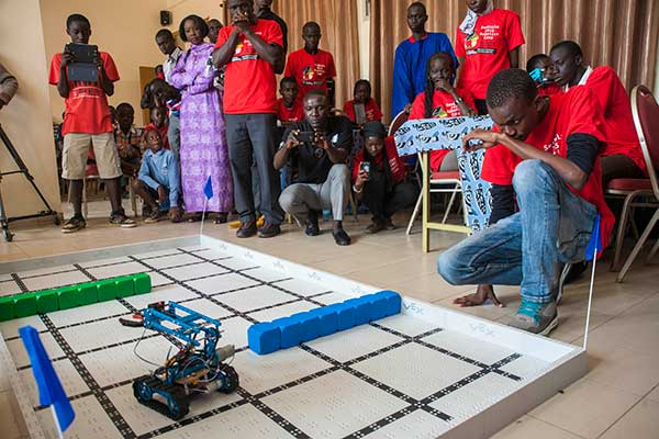 A male student studies the movements of his team's robot during the third day of the SenEcole robotics camp in Dakar, Senegal this past March.