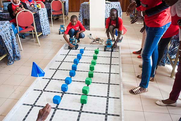 Two students prepare to race their robots during the third and final day of the SenEcole robotics camp in Dakar, Senegal this past March.