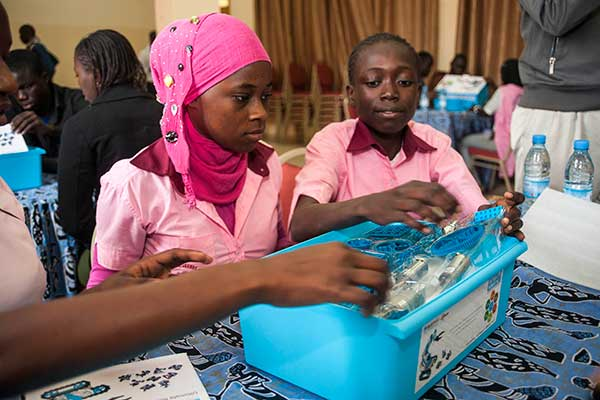 Students begin assembling a robot at the SenEcole robotics camp in Dakar, Senegal this past March.