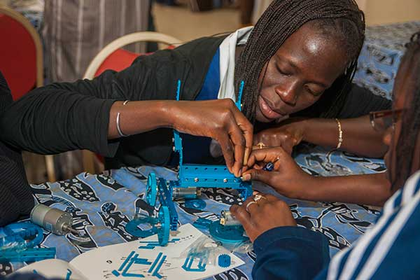 A students helps to assemble her team's robot at the SenEcole robotics camp in Dakar, Senegal this past March.