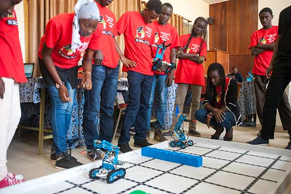 Two teams of students test their robots on the competition field during the third day of the SenEcole robotics camp in Dakar, Senegal this past March.