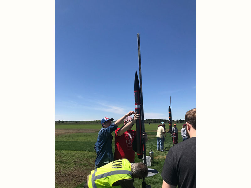 The Husker Rocketry Team setting up their rocket for take off.